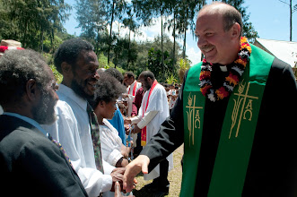 Photo: Rev. John Mehl congratulating the newly baptized members of the Gutnius Lutheran Church in Papua New Guinea.