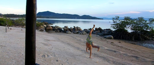 Photo: My sloppy cartwheels in the sand. Long gone are the glory gymnastics days in university.