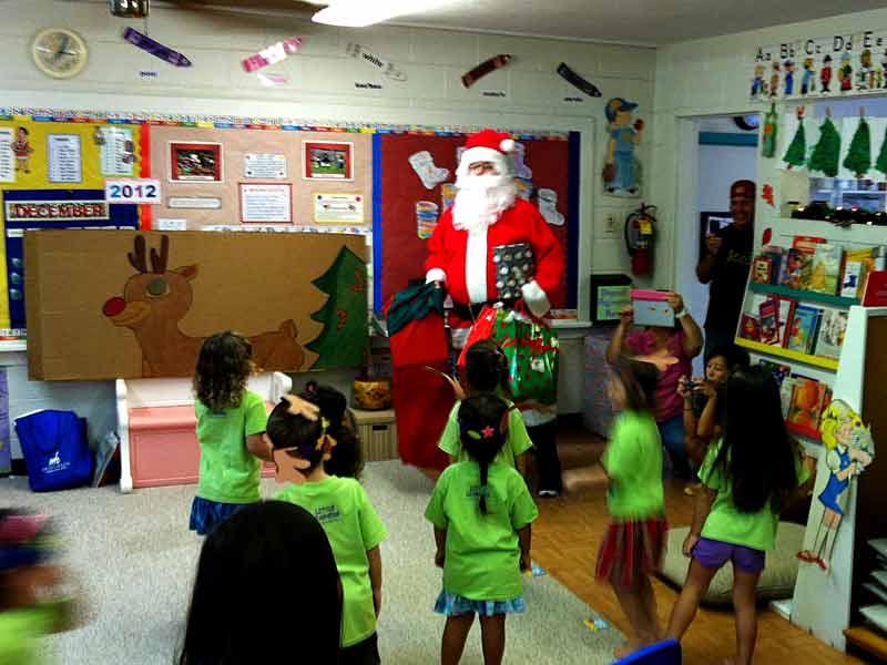 Photo: Tsai-ko Santa (Da Punchbowl Kid) makes his annual visit to Little Learner's Preschool on December 19, 2012