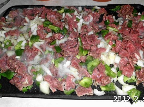 Cut steak in thin bite size pcs.  Cut veggies into bite size pcs....