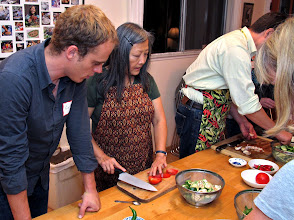 Photo: Kasma shows Lukas how big to cut the tomatoes for the stir-fry