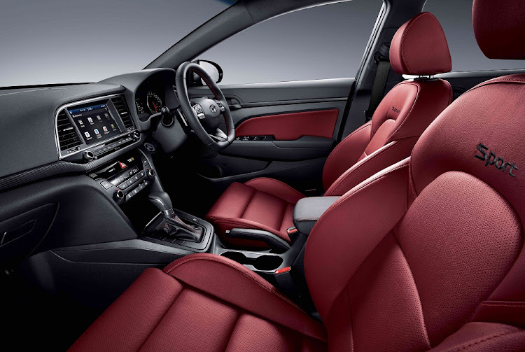 The interior has gone more upmarket and you can even have bright red leather in the Sport model.   Picture: HYUNDAI SA