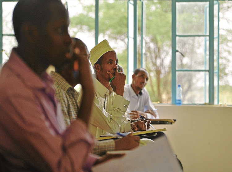Students attend a lecture at Garissa University in northeastern Kenya. it reopened with tight security nine months after a deadly siege by gunmen led to the death of 148 people, mostly students. Picture: GALLO IMAGES/AFP/TONY KARUMBA
