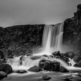 Öxarárfoss by Ruslan Stepanov - Black & White Landscapes ( clouds, black and white, waterfall, long exposure, rocks, öxarárfoss )