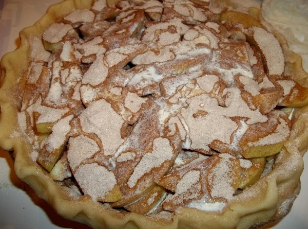 Sprinkle remaining sugar mixture over apples and pour heavy cream evenly over apples and...