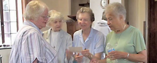Photo: In between meetings at the Motherhouse in Bensalem, the sisters enjoy sharing a photograph.