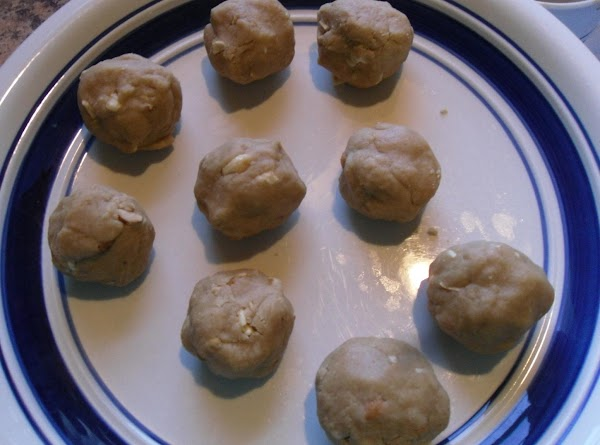 Drop round teaspoonfuls of the mixture onto a baking sheet and depress the balls...