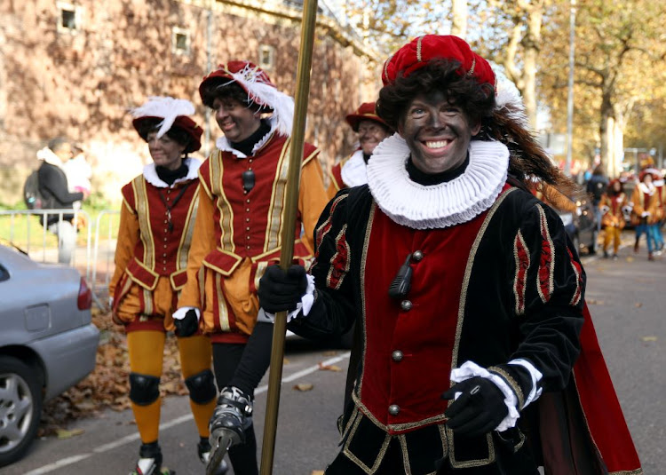 """Zwarte Piet"" (Black Pete), who are a Saint Nicholas's assistants are seen during a traditional parade in Amsterdam, Netherlands, on November 18 2018."
