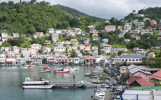 grenada-harbor2.jpg - Houses overlooking the pretty harbor of St. George's, Grenada.