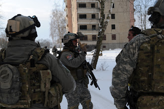 Photo: On 15 Feb 2010, Special Forces Soldiers have an After Action Review (AAR), after exiting the cleared building. This is rehearsal for a night reconnaissance training mission in Germany.  (U.S. Army Photo by: SFC Silas Toney)