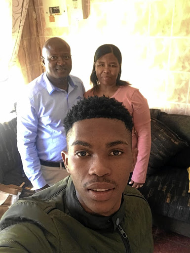 Gift Links at home on holiday with his parents, Jacob and Dikeledi.