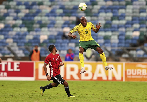 Bafana Bafana's Sifiso Hlanti heads the ball with Libya's Anias Sabbouof during their Africa Cup of Nations qualifier at Moses Mabhida Stadium in Durban.
