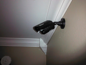 Photo: Security cameras in rooms and alarms on doors by ADT