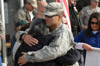 Photo: Sgt. 1st Class Robert Bostic II, returning OMLT member, greets family and friends.  The twelve Soldiers making up the Operational Mentoring Liaison Team (OMLT) from the Minnesota Army National Guard returned to Minnesota from a one-year deployment to Afghanistan in support of Operation Enduring Freedom on Nov. 6.