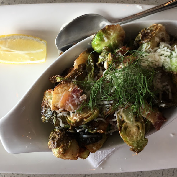 Crispy Brussels Sprouts (Appetizer) with Parmesan cheese, bacon and garlic.