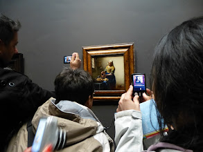 Photo: People taking pictures of pictures