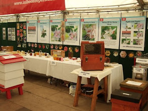 Photo: The Institute of Northern Ireland Beekeepers stand prepared to receive visitors.