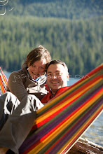 Photo: Young couple sitting in hammock on Jackson Lake. Grand Teton NP, WY