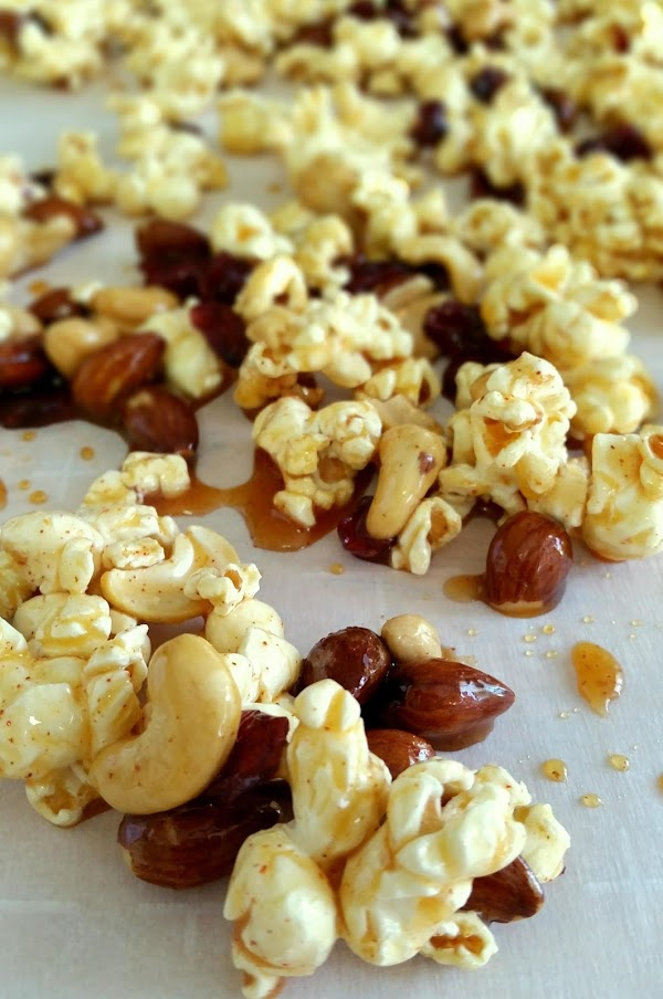 Pour the hot, sugary, maple goodness over the popped corn. Toss to coat. Spread...