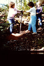 Photo: Grand-kids helping dig post-holes.