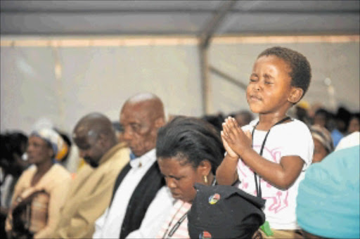 LEARNING YOUNG : A young girl attends the prayer service for the gang-rape video victim in Doornkop recreation centre in Soweto. Photo: Tsheko Kabasia