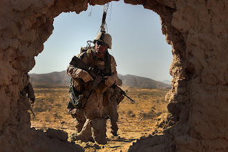 Photo: Cpl. Theesit Klinman, a rifleman with India Battery, 3rd Battalion, 12th Marine Regiment, Regimental Combat Team 2, from Orange County, Calif., searches a compound near the Kajaki Dam for suspicious activity, Sept. 29, 2010. Klinman, 24, is from Orange County, Calif.