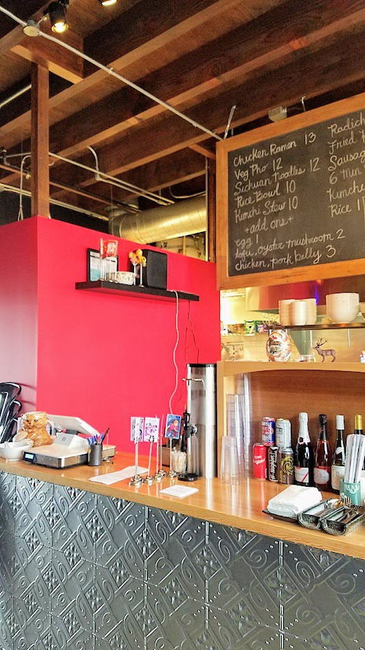 Register and menu board at Wares at the Zipper