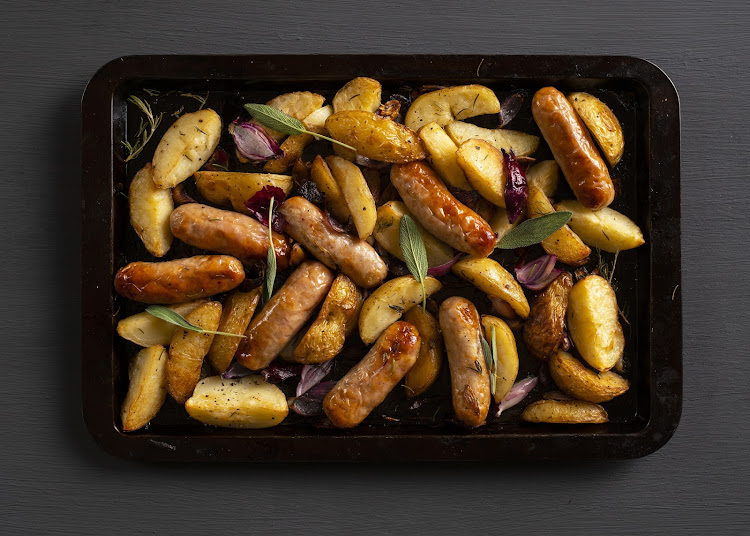 Rosemary roasted sausage and potato wedge tray bake.