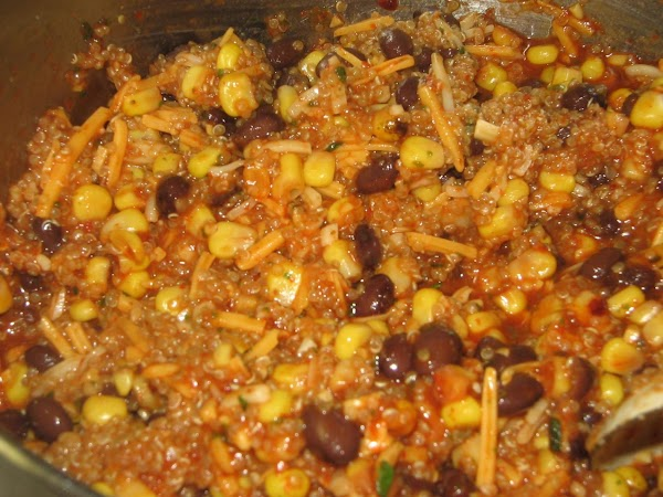 In a large bowl combine  the cooked quinoa, enchilada sauce, corn(you can use...