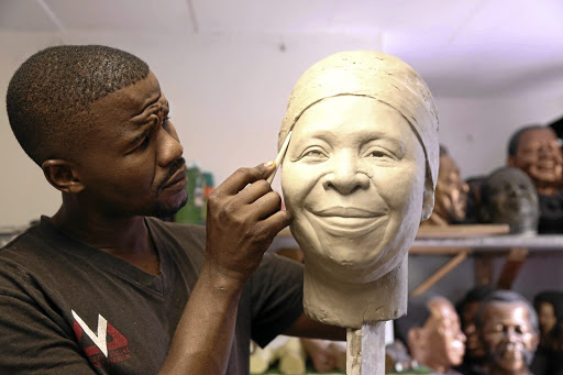 Wax sculptor Lungelo Gumede working on his sculpture of Nkosazana Dlamini-Zuma.