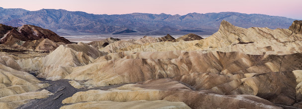 """Photo: The King is coming Death Valley, CA. 2013.  By the time I made this panorama, we were no longer alone at Zabrisky Point. The whole point was full of photographers, their backpacks, and of course their tripods.  This was the moment of anticipation, the countdown until the sun began lighting up the background mountains, and eventually Manly Beacon, and finally the hills all around us.  It reminded me of waking on El Capitan in Yosemite, and waiting in my sleeping bag, watching the sun crash onto the rock above me, and begin to creep down towards my camp, and finally down to the valley, that was the moment when my friend Nick would yell: """"Here comes the Kiiiinnnngggg!!"""".  To get the full effect of this shot, click this link and view the full 60 megapixel pano at gigapan.  http://gigapan.com/gigapans/121971  This panorama was created by stitching together 5 exposures from my D7000 using photoshop, then adjusted in lighroom, kind of crazy to think that pretty soon this might just be a single exposure from a DSLR. (Nikon D800 is 36, so its just a hop, skip, and a jump to 60)"""