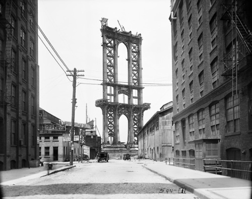 """Photo: Genesis of a icon:  """"In this June 5, 1908 photo, the Manhattan Bridge is less than a shell, seen from Washington Street. It wouldn't be opened for another 18 months and wouldn't be completed for another four years.""""  http://www.dailymail.co.uk/news/article-2134408/Never-seen-photos-100-years-ago-tell-vivid-story-gritty-New-York-City.html#ixzz20pR458mD"""
