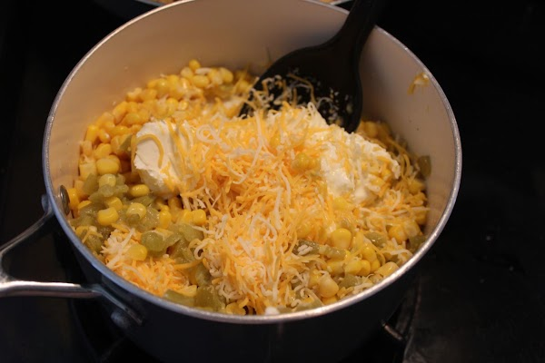 In saucepan put corn, cream cheese, jalapenos, milk, and half of the shredded cheese.