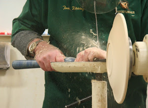 Photo: Gently scraping the tool marks out of the shape by the rim.
