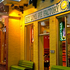 Key West Open Door by Denise Zimmerman - Buildings & Architecture Architectural Detail ( shop, building, bench, store, espresso, keys, green, door, store front, key west, yellow, key lime pie factory, pie, key lime, cappuccino, florida, factory, archiitecture, x-exterior )