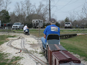 Photo: Doug Gillory pulling his 2-8-0 chassis and Peter Bryan with ATSF 2110