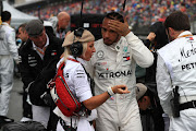 Mercedes-Benz driver Lewis Hamilton speaks to his personal trainer at Hockenheimring in Hockenheim, Germany, on Sunday. The champion driver made mistakes in the race at the weekend, saying he had never felt so sick.