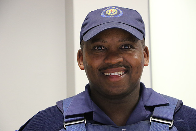 Constable Luyolo Nojulumba has been hailed a hero after he caught a baby who was thrown from a shack rooftop