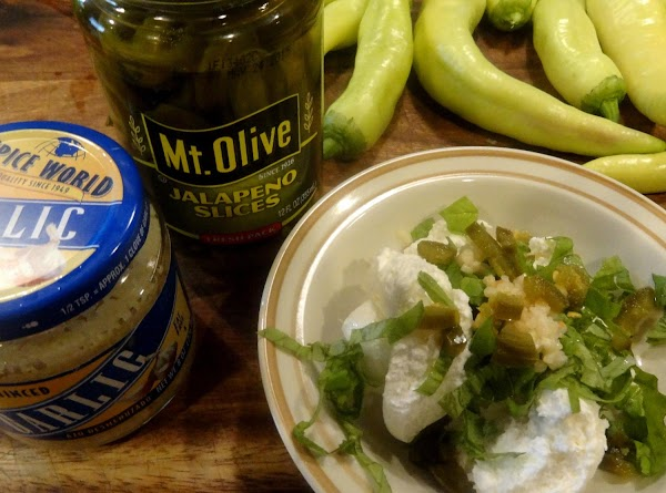Combine the creamed cheese and chives, minced garlic,  chopped basil, and chopped jalapeno...