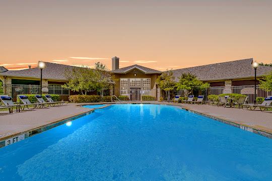 Summit Ridge Apartments sparking pool at dusk