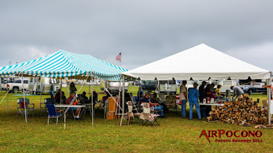 Photo: Track provided tent on the right, Russ' giant canopy on the left. We had plenty of shelter - thanks Russ!