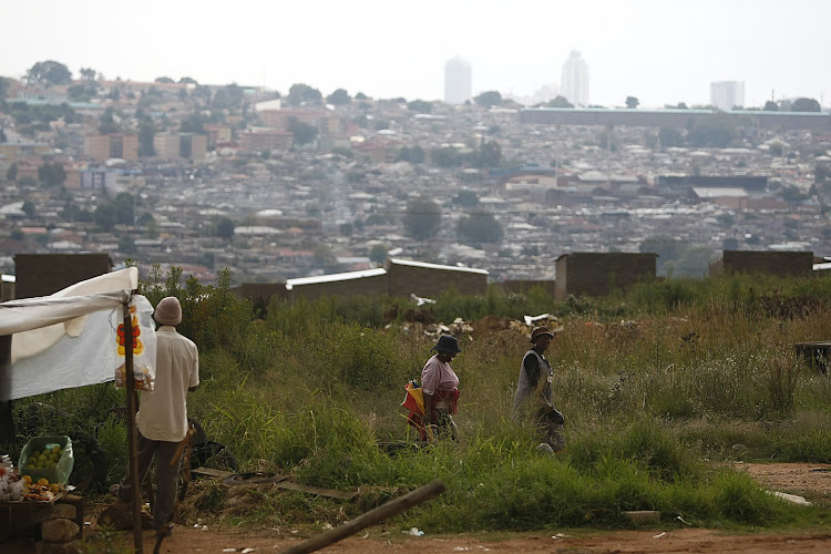 Sandton skyline seen from Alexandra township. The juxtaposition between the rich and the poor is especially evident in Alexandra, where some of South Africa's poorest live in the shadow of some of the country's richest.