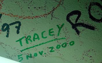Photo: Tracey Eaton writes name on wall of Bodeguita del Medio. Tracey Eaton photo.