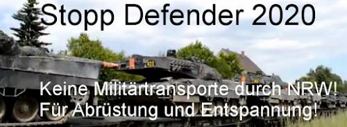 Banner: Foto von Panzertransport, darüber «Stopp Defender 2020. Keine Militärtransporte durch NRW! Für Abrüstung und Entspannung!».