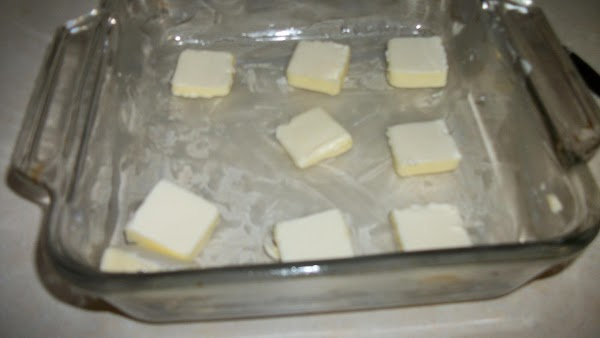 Slice butter and spread on bottom 8X8 baking dish.Then I lined up the slices.