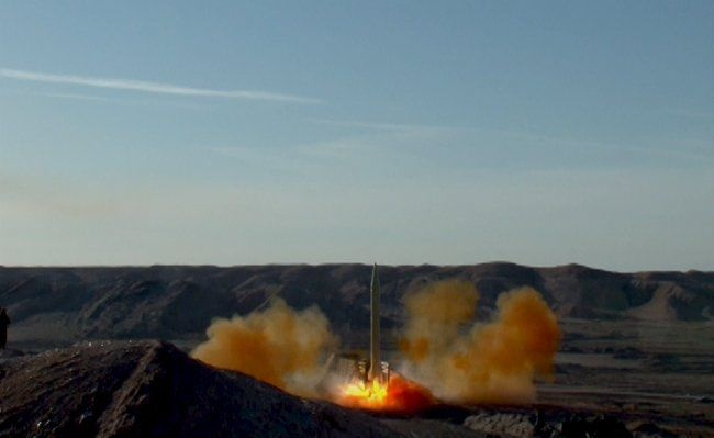 A ballistic missile is launched and tested in an undisclosed location in Iran. Picture: REUTERS