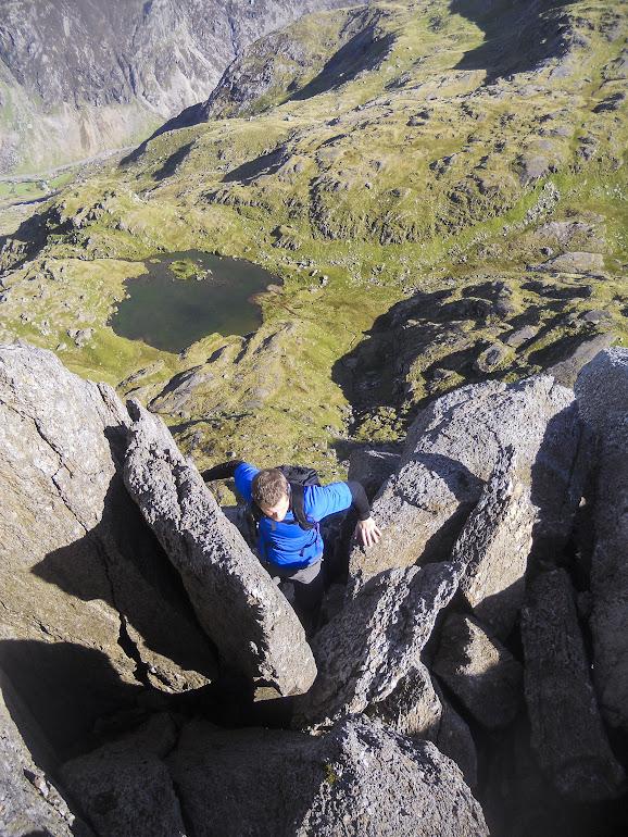 Getting over the tumbled boulders on Clogwyn y Person - Llyn Glas down below