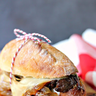 Steak Sandwiches with Caramelized Onions and Provolone Cheese.