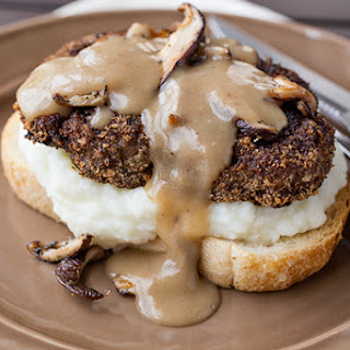 Open-Faced, Crispy-Fried Meatloaf Patty Sandwich with Creamy Whipped Potatoes, topped with Gravy & Seared Shiitake Mushrooms