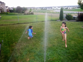 Photo: Helping Grandpa water the lawn